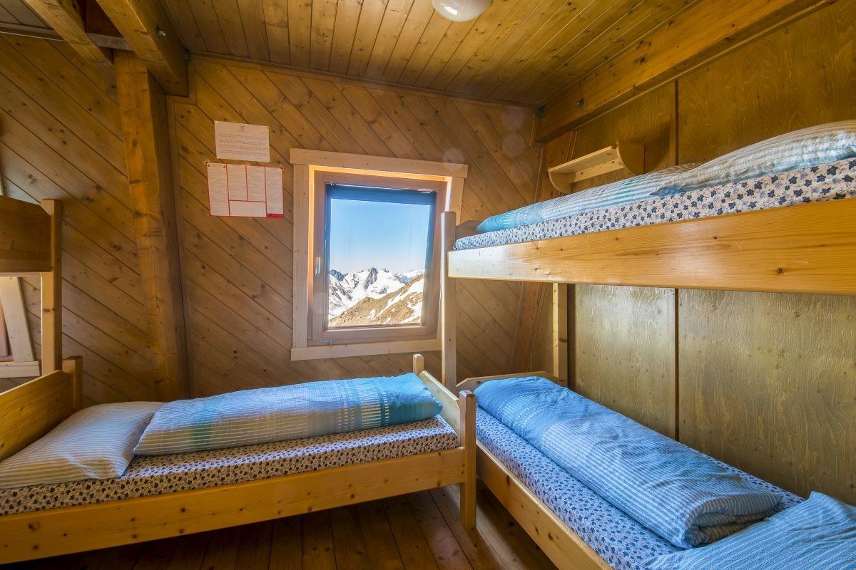 Wakker worden met dit uitzicht, gewoon wauw! Dorm in Rif. Mantova al Vioz © Fototeca Trentino Sviluppo S.p.A. - G. Calzà