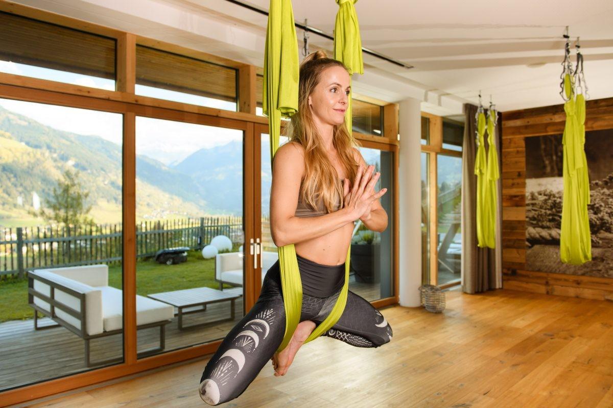 Heb jij al eens een lesje Aereal-yoga geprobeerd? Foto: Gasteinertal Tourismus GmbH